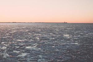 sunset over frozen sea - vintage retro effect