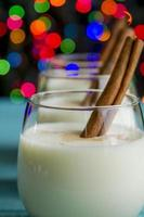 Festive Egg Nog with Cinnamon and Cookies photo