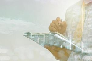 Double exposure of businessman and building