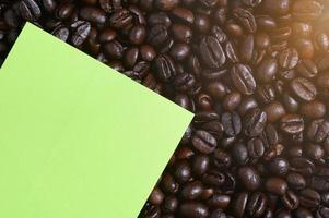 Note paper and coffee beans, top view