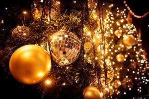 Christmas tree with gold ball and bokeh lights background