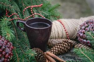 Сup of hot tea on a rustic wooden table. photo