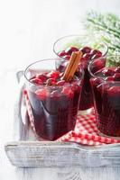 glass of mulled wine with cranberry and spices, winter drink