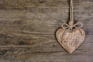 Wooden heart on vintage oak background, text space