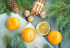 Christmas still life with mandarins and cinnamon. Top view.