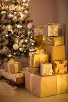 gold and silver Christmas gifts under the Christmas tree, photo