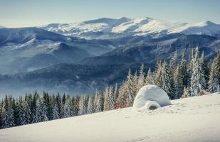 yurt  in winter fog mountains. Carpathian, Ukraine, Europe. photo