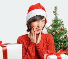 Surprised woman in santa hat
