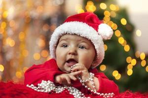 navidad bebe con gorro de santa foto