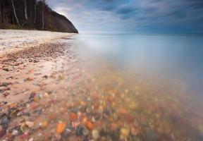 Rocky sea shore at sunrise. Beautiful seascape