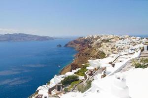 Oia, traditional greek village and Aegan sea, Greece photo