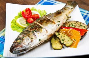 fish, sea bass grilled with lemon and  vegetables