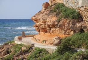 Curved path along coastal pathway photo