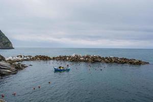 Colorful harbor, Riomaggiore, Cinque Terre, Italy photo