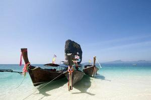 Adaman sea and wooden boat in Thailand. Tourism background with