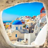 Santorini blue dome church look through the chimney, Greece