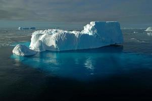 Antarctic iceberg with shimmering underwater ice