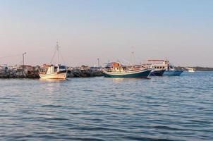 Agios Sostis port at sunset photo