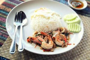 Sea food with basil and egg served with rice