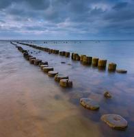 Sandy shore of Baltic sea and torpedownia near Gdynia. photo