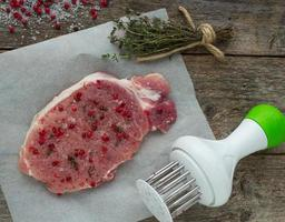 raw pork steak with pink pepper, thyme and sea salt