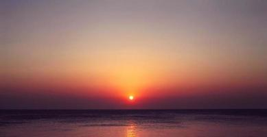 Scenic landscape view of the sea with beautiful evening sunset photo