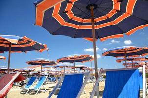 Beach umbrellas on beautiful beach in Marina di Pisa, Italy