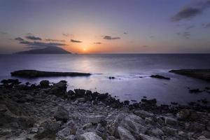 Rocky coast during sunset in Greece.