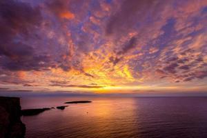 Menorca sunset in Cap de Caballeria cape at Balearic photo