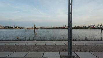 Hamburg harbor with promenade and ships timelapse