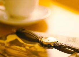 wrist watch and coffee cup
