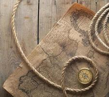 old compass and rope on vintage map 1732 photo
