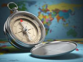 Compass on world map background. Navigation. photo