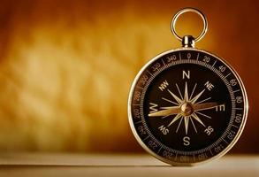 Magnetic compass against a vintage background photo