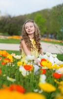 Girl with beautiful orange and yellow poppies photo
