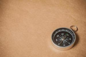 Compass on Light Brown Background photo