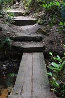 Pedestrian wood bridge over stream. photo