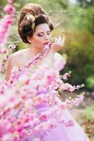 Woman in pink gown photo