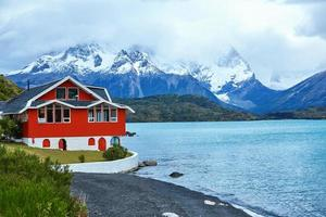 Red house on Pehoe lake in Torres del Paine photo