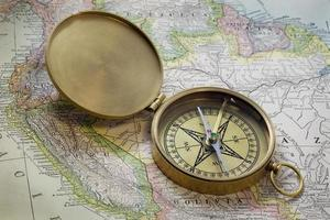 brass compas over vintage South America map