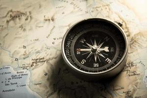Vintage filtered of compass with map. photo
