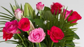 Red roses in a vase symbolic of love and compassion