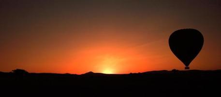 Balloon silhouette at sunrise photo