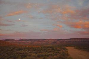 Scenic view on a distant red canyons photo