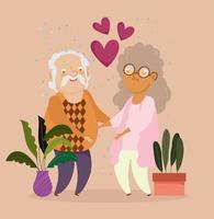 pareja de ancianos con plantas en maceta y corazones