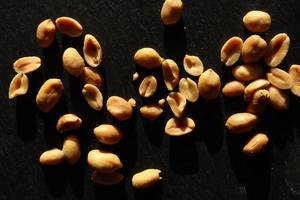 Photography of a handful of peanuts on slate for food background