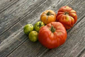 Colorful tomatos on a wooden board