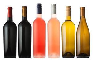 Mixed wine bottles on white