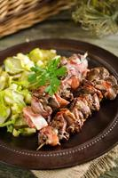 Grilled chicken liver skewers with bacon
