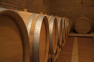 Wooden barrels in wine cellar.